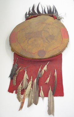 Plains. <em>Drum</em>, early nineteenth century. Hide, buffalo horn, horsehair, dyed owl feathers, stroud wool cloth, small eagle feathers, pigment, metal nails, 1 15/16 x 1 15/16 x 19 11/16 in. (5 x 5 x 50 cm). Brooklyn Museum, Anonymous gift in memory of Dr. Harlow Brooks, 43.201.135. Creative Commons-BY (Photo: Brooklyn Museum, CUR.43.201.135_view1.jpg)