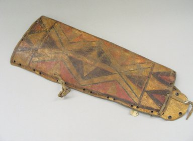 Sioux. <em>Warrior Bag</em>, 19th century. Rawhide, pigment, cloth, 20 3/8 x 7 1/2 x 1 in. (51.8 x 19.1 x 2.5 cm). Brooklyn Museum, Anonymous gift in memory of Dr. Harlow Brooks, 43.201.143. Creative Commons-BY (Photo: Brooklyn Museum, CUR.43.201.143.jpg)