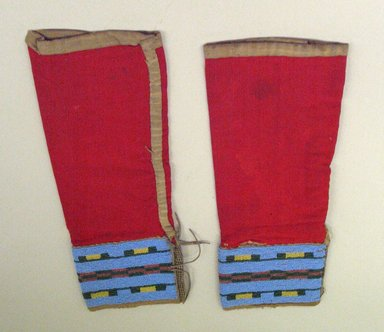 Ute. <em>Leggings with Beaded Cuffs</em>. Cotton cloth, hide, beads, 29 x 13 cm. Brooklyn Museum, Anonymous gift in memory of Dr. Harlow Brooks, 43.201.1a-b. Creative Commons-BY (Photo: Brooklyn Museum, CUR.43.201.1a-b.jpg)