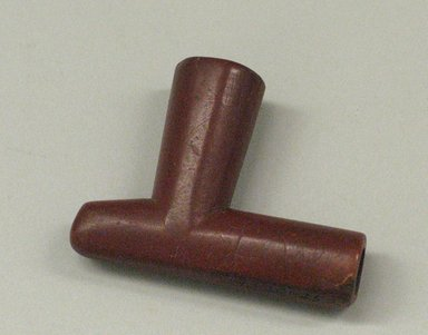 Plains. <em>Pipe</em>, 19th century. Catlinite (pipestone), 3 3/8 x 2 9/16 in. (8.6 x 6.5 cm). Brooklyn Museum, Anonymous gift in memory of Dr. Harlow Brooks, 43.201.252. Creative Commons-BY (Photo: Brooklyn Museum, CUR.43.201.252.jpg)