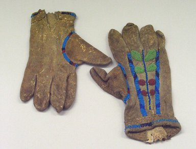 Probably Blackfoot. <em>Pair of Gloves</em>, 1900-1940. Hide, beads, 10 5/8 x 6 1/2 in. (27 x 16.5 cm). Brooklyn Museum, Anonymous gift in memory of Dr. Harlow Brooks, 43.201.27a-b. Creative Commons-BY (Photo: Brooklyn Museum, CUR.43.201.27a-b.jpg)