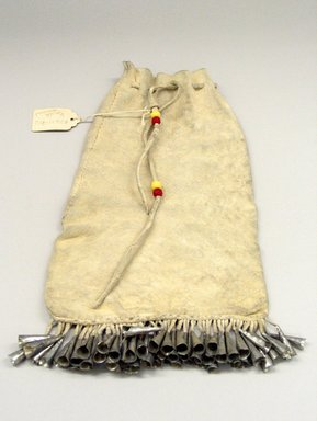 Plains. <em>Drawstring Bag</em>, 20th century. Buckskin, tin, beads, sinew, 11 1/2 x 6 1/2 in. (29.2 x 16.5 cm). Brooklyn Museum, Anonymous gift in memory of Dr. Harlow Brooks, 43.201.283. Creative Commons-BY (Photo: Brooklyn Museum, CUR.43.201.283.jpg)