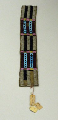 Hunkpapa, Lakota, Sioux. <em>Beaded Band</em>, 1900-1940. Hide, beads, 16 1/8 x 2 9/16 in. (41 x 6.5 cm). Brooklyn Museum, Anonymous gift in memory of Dr. Harlow Brooks, 43.201.49. Creative Commons-BY (Photo: Brooklyn Museum, CUR.43.201.49_view1.jpg)
