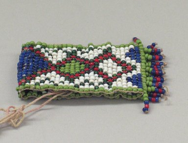 Plains. <em>One of a Pair of Tiny, Woven, Beaded Bracelets</em>, 20th century. Beads, 2 3/4 x 1 3/8 in. (7 x 3.5 cm). Brooklyn Museum, Anonymous gift in memory of Dr. Harlow Brooks, 43.201.58a. Creative Commons-BY (Photo: Brooklyn Museum, CUR.43.201.58a_view1.jpg)