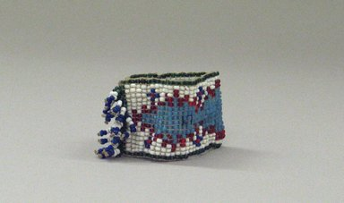 Plains. <em>One of a Pair of Tiny, Woven, Beaded Bracelets</em>, 20th century. Beads, 2 3/4 x 1 3/8in. (7 x 3.5cm). Brooklyn Museum, Anonymous gift in memory of Dr. Harlow Brooks, 43.201.58b. Creative Commons-BY (Photo: Brooklyn Museum, CUR.43.201.58b_view1.jpg)