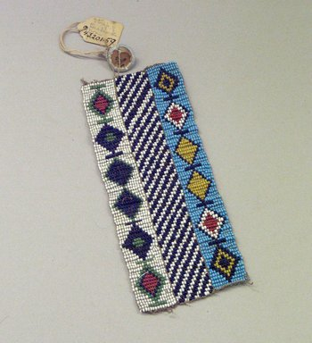 Plains. <em>Woven Beadwork Strip with Diamond Pattern</em>, early 20th century. Beads, 5 7/8 x 2 3/8 in. (14.9 x 6 cm). Brooklyn Museum, Anonymous gift in memory of Dr. Harlow Brooks, 43.201.59. Creative Commons-BY (Photo: Brooklyn Museum, CUR.43.201.59.jpg)