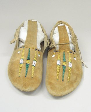 Arapaho Northern. <em>Pair of Moccasins</em>, early 20th century. Hide, beads, 10 5/8 x 3 15/16 in. (27 x 10 cm). Brooklyn Museum, Anonymous gift in memory of Dr. Harlow Brooks, 43.201.70a-b. Creative Commons-BY (Photo: Brooklyn Museum, CUR.43.201.70a-b_view3.jpg)