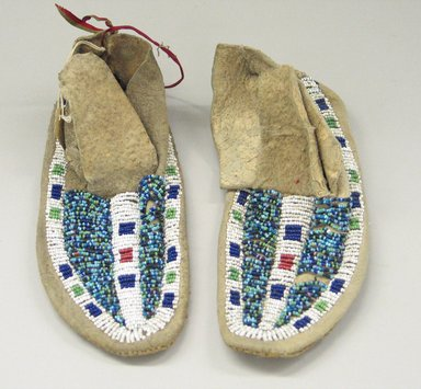Probably Sioux. <em>Pair of Boy's Moccasins</em>, early 20th century. Rawhide, beads, 7 1/2 x 2 3/4 in. (19.1 x 7 cm). Brooklyn Museum, Anonymous gift in memory of Dr. Harlow Brooks, 43.201.76a-b. Creative Commons-BY (Photo: Brooklyn Museum, CUR.43.201.76a-b_view1.jpg)