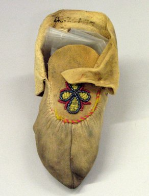 Possibly Cree. <em>Child's Moccasin</em>, early 20th century. Buckskin, 6 1/8 x 3 1/8 in. (15.6 x 7.9 cm). Brooklyn Museum, Anonymous gift in memory of Dr. Harlow Brooks, 43.201.77. Creative Commons-BY (Photo: Brooklyn Museum, CUR.43.201.77.jpg)