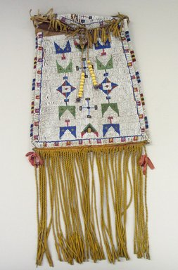 Cheyenne. <em>Medicine Bag</em>, late 19th century. Rawhide, beads, metal, ribbon, 11 13/16 x 9 5/8 in. (30 x 24.4 cm). Brooklyn Museum, Gift as a memorial to Dr. Harlow Brooks, 43.87.77. Creative Commons-BY (Photo: Brooklyn Museum, CUR.43.87.77_view1.jpg)