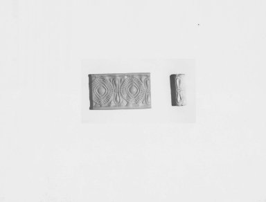 Ancient Near Eastern. <em>Cylinder Seal</em>, late 4th millennium B.C.E. Faience (?), 1 3/16 x Diam. 3/8 in. (3 x 1 cm). Brooklyn Museum, Charles Edwin Wilbour Fund, 44.123.147. Creative Commons-BY (Photo: Brooklyn Museum, CUR.44.123.147_NegA_print_bw.jpg)