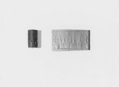 Ancient Near Eastern. <em>Cylinder Seal: Three Combat Groups</em>, 2300 B.C.E. Serpentine, 1 x Diam. 9/16 in. (2.5 x 1.5 cm). Brooklyn Museum, Charles Edwin Wilbour Fund, 44.123.177. Creative Commons-BY (Photo: Brooklyn Museum, CUR.44.123.177_NegA_print_bw.jpg)