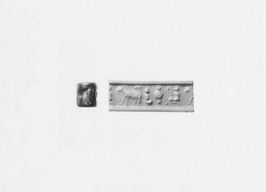Ancient Near Eastern. <em>Cylinder Seal</em>, ca. 3100 B.C.E. Steatite, 3/4 x Diam. 9/16 in. (1.9 x 1.5 cm). Brooklyn Museum, Charles Edwin Wilbour Fund, 44.123.178. Creative Commons-BY (Photo: Brooklyn Museum, CUR.44.123.178_NegA_print_bw.jpg)