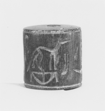 <em>Cylinder Seal</em>, ca. 3100-2800 B.C.E. Egyptian ebony, 1 3/8 x 1 5/16 in. (3.5 x 3.4 cm). Brooklyn Museum, Charles Edwin Wilbour Fund, 44.123.28. Creative Commons-BY (Photo: , CUR.44.123.28_NegA_print_bw.jpg)
