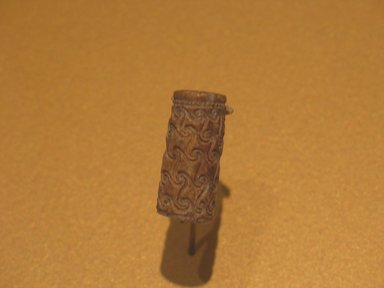 <em>Cylinder Seal with Interlocking Scrolls</em>, ca. 1938-1759 B.C.E. Steatite, glaze, 1 1/4 x 9/16 in. (3.1 x 1.4 cm). Brooklyn Museum, Charles Edwin Wilbour Fund, 44.123.36. Creative Commons-BY (Photo: Brooklyn Museum, CUR.44.123.36_erg2.jpg)