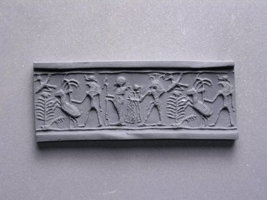 <em>Cylinder Seal</em>, ca. 1352-1292 B.C.E. Steatite, glaze, 5/8 x 3/8 in. (1.6 x 0.9 cm). Brooklyn Museum, Charles Edwin Wilbour Fund, 44.123.42. Creative Commons-BY (Photo: Brooklyn Museum, CUR.44.123.42_impression.jpg)