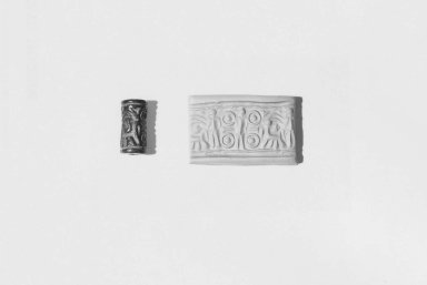 Ancient Near Eastern. <em>Cylinder Seal</em>, ca. 15th-12th century B.C.E. Steatite, glaze, 13/16 x Diam. 3/8 in. (2.1 x 1 cm). Brooklyn Museum, Charles Edwin Wilbour Fund, 44.123.45. Creative Commons-BY (Photo: Brooklyn Museum, CUR.44.123.45_NegA_print_bw.jpg)