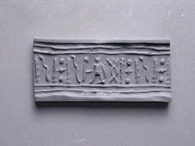 Egyptian. <em>Cylinder Seal</em>. Faience, 11/16 x Diam. 3/8 in. (1.8 x 0.9 cm). Brooklyn Museum, Charles Edwin Wilbour Fund, 44.123.46. Creative Commons-BY (Photo: Brooklyn Museum, CUR.44.123.46_impression.jpg)