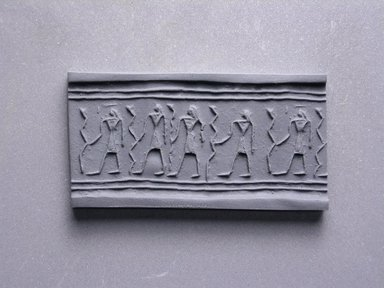<em>Cylinder Seal</em>, ca. 1539-1292 B.C.E. Frit, 13/16 x 3/8 in. (2 x 1 cm). Brooklyn Museum, Charles Edwin Wilbour Fund, 44.123.50. Creative Commons-BY (Photo: Brooklyn Museum, CUR.44.123.50_impression.jpg)