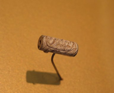 <em>Cylinder Bead of Senwosret I</em>, ca. 1919-1875 B.C.E. Steatite, glaze, 7/8 x 3/8 in. (2.2 x 0.9 cm). Brooklyn Museum, Charles Edwin Wilbour Fund, 44.123.51. Creative Commons-BY (Photo: Brooklyn Museum, CUR.44.123.51_erg2.jpg)