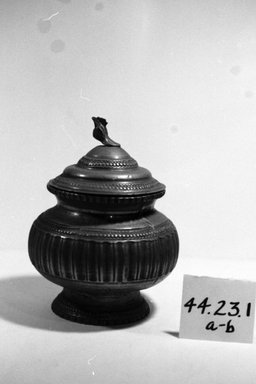 Possibly Dyak. <em>Jar and Cover</em>. Brass Brooklyn Museum, Gift of Mrs. William Sterling Peters, 44.23.1a-b. Creative Commons-BY (Photo: Brooklyn Museum, CUR.44.23.1a-b_bw.jpg)