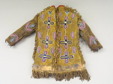 Crow. <em>Indian Boy's Coat</em>, 1880-1920. Hide, beads, bone buttons, fur, wool, 17 11/16 x 12 3/16 in.  (45.0 x 31.0 cm). Brooklyn Museum, 44.27.1. Creative Commons-BY (Photo: Brooklyn Museum, CUR.44.27.1_view1.jpg)
