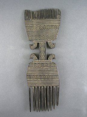 Zulu. <em>Comb</em>, late 19th century. Wood, 3 9/16 x 1/2 x 10 1/4 in. (9 x 1.2 x 26 cm). Brooklyn Museum, Gift of Mrs. Herman Eggers, 45.125.6. Creative Commons-BY (Photo: Brooklyn Museum, CUR.45.125.6_view1.jpg)