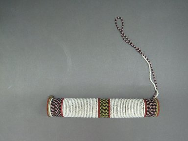Zulu. <em>Tobacco or Pipe Container</em>, 19th century. Wood, glass seed beads, natural fiber, metal, 8 5/8 x 1 3/8 in. (21.9 x 3.5 cm). Brooklyn Museum, Gift of Mrs. Herman Eggers, 45.125.7. Creative Commons-BY (Photo: Brooklyn Museum, CUR.45.125.7_overall.jpg)