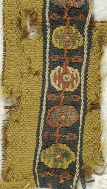 Coptic. <em>Band Fragment with Botanical Decoration</em>, 7th century C.E. Linen, wool, 1 15/16 x 6 1/8 in. (5 x 15.5 cm). Brooklyn Museum, Gift of Pratt Institute, 46.157.13. Creative Commons-BY (Photo: Brooklyn Museum (in collaboration with Index of Christian Art, Princeton University), CUR.46.157.13_detail01_ICA.jpg)