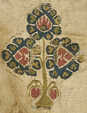 Coptic. <em>Fragment with Botanical Decoration</em>, 6th-7th century C.E. Linen, wool, 9 1/4 x 18 1/8 in. (23.5 x 46 cm). Brooklyn Museum, Gift of Pratt Institute, 46.157.17. Creative Commons-BY (Photo: Brooklyn Museum (in collaboration with Index of Christian Art, Princeton University), CUR.46.157.17_detail01_ICA.jpg)