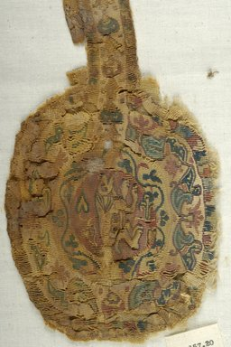 Coptic. <em>Clavus Fragment with Figural, Animal, and Botanical Decoration</em>, 5th-6th century C.E. (possibly). Linen, wool, 4 15/16 x 16 1/8 in. (12.5 x 41 cm). Brooklyn Museum, Gift of Pratt Institute, 46.157.20. Creative Commons-BY (Photo: Brooklyn Museum (in collaboration with Index of Christian Art, Princeton University), CUR.46.157.20_detail01_ICA.jpg)