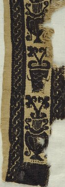 Coptic. <em>Band Fragment with Botanical Decoration</em>, 7th century C.E. Linen, wool, 46.157.27a: 2 5/16 x 13 3/8 in. (5.8 x 34 cm). Brooklyn Museum, Gift of Pratt Institute, 46.157.27a-b. Creative Commons-BY (Photo: Brooklyn Museum (in collaboration with Index of Christian Art, Princeton University), CUR.46.157.27A_detail01_ICA.jpg)