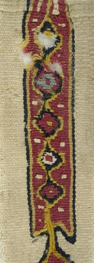 Coptic. <em>Clavus Fragment with Botanical Decoration</em>, 7th century C.E. (probably). Linen, wool, 7 1/16 x 2 3/16 in. (18 x 5.5 cm). Brooklyn Museum, Gift of Pratt Institute, 46.157.5. Creative Commons-BY (Photo: Brooklyn Museum (in collaboration with Index of Christian Art, Princeton University), CUR.46.157.5_detail01_ICA.jpg)