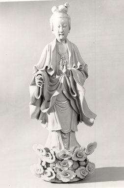 <em>Statue of Standing Figure on Lotus Pedestal</em>, late 17th-early 18th century. Porcelain, 20 3/4 x 7 7/8 in. (52.7 x 20 cm). Brooklyn Museum, Bequest of Mary T. Cockcroft, 46.203.1. Creative Commons-BY (Photo: Brooklyn Museum, CUR.46.203.1_bw.jpg)