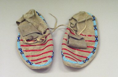 Sioux. <em>Pair of Moccasins</em>, 1900-1940. Beads, porcupine quills, hide, plant fibers?, 10 1/4 x 3 7/8 in. or (26.0 x 10.0 cm). Brooklyn Museum, Charles Stewart Smith Memorial Fund, 46.96.8a-b. Creative Commons-BY (Photo: Brooklyn Museum, CUR.46.96.8a-b_view1.jpg)