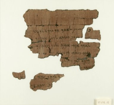 <em>Papyrus Fragments Inscribed in Aramaic</em>, May 1, 446 B.C.E. (probably). Papyrus, ink, Glass: 8 13/16 x 9 15/16 in. (22.4 x 25.3 cm). Brooklyn Museum, Bequest of Theodora Wilbour from the collection of her father, Charles Edwin Wilbour, 47.218.12 (Photo: Brooklyn Museum, CUR.47.218.12_IMLS_PS5.jpg)