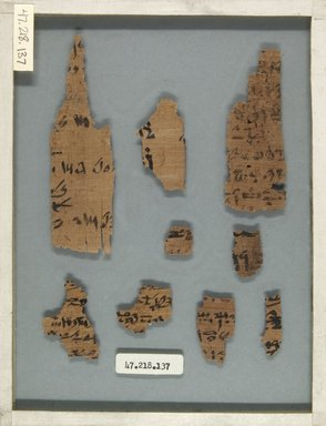 <em>Papyrus Fragments Inscribed in Hieratic and Demotic</em>, 664 B.C.E.-395 C.E. Papyrus, ink, Glass: 6 1/8 x 8 1/16 in. (15.5 x 20.5 cm). Brooklyn Museum, Bequest of Theodora Wilbour from the collection of her father, Charles Edwin Wilbour, 47.218.137 (Photo: Brooklyn Museum, CUR.47.218.137_front_IMLS_PS5.jpg)