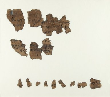 <em>Papyrus Fragments Inscribed in Aramaic</em>, 402-401 B.C.E. Papyrus, ink, Largest Fragment: 2 9/16 × 1 13/16 in. (6.5 × 4.6 cm). Brooklyn Museum, Bequest of Theodora Wilbour from the collection of her father, Charles Edwin Wilbour, 47.218.13a-b (Photo: Brooklyn Museum, CUR.47.218.13b_recto_IMLS_PS5.jpg)
