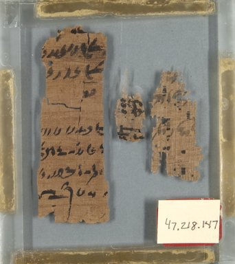 Demotic. <em>Papyrus Fragments Inscribed in Demotic</em>, 305-30 B.C.E.	. Papyrus, ink, Largest Fragment: 3 3/8 × 1 in. (8.5 × 2.5 cm). Brooklyn Museum, Bequest of Theodora Wilbour from the collection of her father, Charles Edwin Wilbour, 47.218.147 (Photo: Brooklyn Museum, CUR.47.218.147_front_IMLS_PS5.jpg)