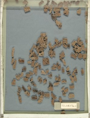<em>Eight Groups of Papyrus Fragments Inscribed in Demotic and Greek</em>, 664 B.C.E.-395 C.E. Papyrus, ink, 47.218.17a-3: Largest fragment: 2 9/16 × 1 9/16 in. (6.5 × 4 cm). Brooklyn Museum, Bequest of Theodora Wilbour from the collection of her father, Charles Edwin Wilbour, 47.218.17a-f (Photo: Brooklyn Museum, CUR.47.218.17a_1_back_IMLS_PS5.jpg)