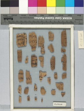 <em>Papyrus Fragments Inscribed in Hieratic and Demotic</em>, 664-30 B.C.E. Papyrus, ink, Glass: 6 1/8 x 8 1/4 in. (15.5 x 21 cm). Brooklyn Museum, Bequest of Theodora Wilbour from the collection of her father, Charles Edwin Wilbour, 47.218.60 (Photo: Brooklyn Museum, CUR.47.218.60_front_IMLS_PS5.jpg)