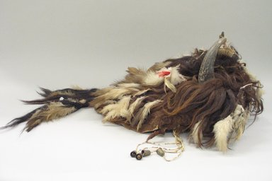 Blackfoot. <em>Buffalo Bull Society Bonnet</em>, 1801-1833. Buffalo hide, white eagle down, buffalo horns, beads, flannel, brass discs, porcupine quills, thimble pendant, hair, wool, 36 x 14 1/2in. (91.4 x 36.8cm). Brooklyn Museum, By exchange, 48.116.8. Creative Commons-BY (Photo: Brooklyn Museum, CUR.48.116.8_view1.jpg)