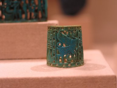 <em>Openwork Ring</em>, ca. 1070-718 B.C.E. Faience, glazed, 1 x 1 in. (2.6 x 2.6 cm). Brooklyn Museum, Charles Edwin Wilbour Fund, 48.203. Creative Commons-BY (Photo: Brooklyn Museum, CUR.48.203_wwg8.jpg)