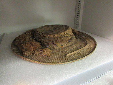 Maohi (Tahitian). <em>Straw Hat with Fibre Band</em>, before 1900. Plant fiber, 13 in. (33 cm). Brooklyn Museum, Gift of Mrs. James C. Pryor, 48.31.1. Creative Commons-BY (Photo: , CUR.48.31.1_overall.jpg)