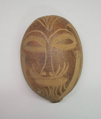 <em>Mask</em>, 20th century. Gourd, 5 1/8 x 3 1/2 x 1 1/2 in. (13 x 8.9 x 3.8 cm). Brooklyn Museum, Gift of Mrs. James C. Pryor, 48.31.28. Creative Commons-BY (Photo: Brooklyn Museum, CUR.48.31.28.jpg)