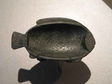 <em>Fish Dish</em>, ca. 1479-1400 B.C.E. Steatite, 13/16 x 2 5/16 x 4 5/16 in. (2 x 5.8 x 11 cm). Brooklyn Museum, Gift of Mr. and Mrs. Alastair B. Martin, 48.56. Creative Commons-BY (Photo: Brooklyn Museum, CUR.48.56_erg456.jpg)