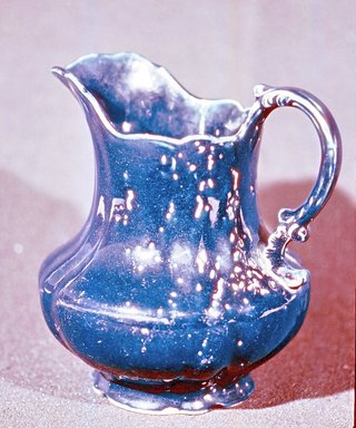 American Pottery Company (1833-1845). <em>Pitcher</em>, 1833-1845. Stoneware body with heavy blue glaze, H: 7 3/4 in. (19.7 cm). Brooklyn Museum, Gift of Arthur W. Clement, 49.1.1. Creative Commons-BY (Photo: Brooklyn Museum, CUR.49.1.1.jpg)