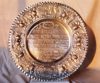 <em>Seder Plate</em>, ca. 1900. Parcel-gilt silver, 16 1/8 x 16 1/8 in. (41 x 41 cm). Brooklyn Museum, Purchased with funds given by Louis M. Rabinowitz, 49.228.1. Creative Commons-BY (Photo: Brooklyn Museum, CUR.49.228.1.jpg)