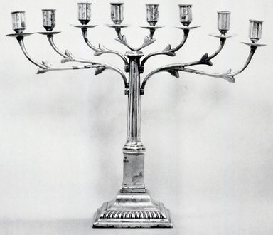 German. <em>Hanukkah Menorah</em>, ca. 1820. Silver-plate, 14 1/2 x 16 x 4 in. (36.8 x 40.6 x 10.2 cm). Brooklyn Museum, Purchased with funds given by Moses Spatt, 49.228.3. Creative Commons-BY (Photo: Brooklyn Museum, CUR.49.228.3.jpg)
