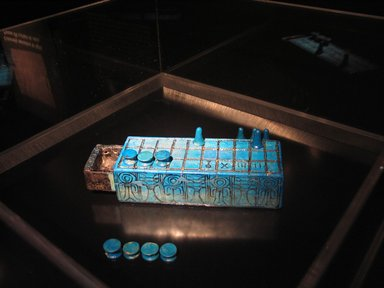 <em>Gaming Board Inscribed for Amenhotep III with Separate Sliding Drawer</em>, ca. 1390-1353 B.C.E. Faience, 2 3/16 x 3 1/16 x 8 1/4 in. (5.5 x 7.7 x 21 cm). Brooklyn Museum, Charles Edwin Wilbour Fund, 49.56a-b. Creative Commons-BY (Photo: , CUR.49.56a-b_49.57.1-.13_tlf.jpg)